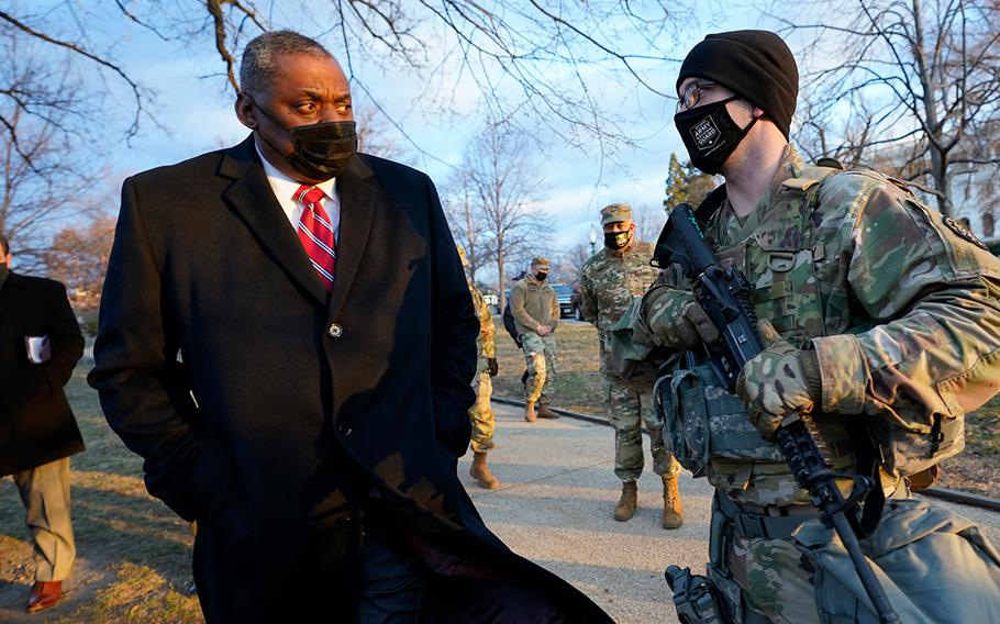 Secretary of Defense Lloyd Austin visits National Guard troops deployed at the U.S. Capitol and its perimeter, Friday, Jan. 29, 2021 on Capitol Hill in Washington.