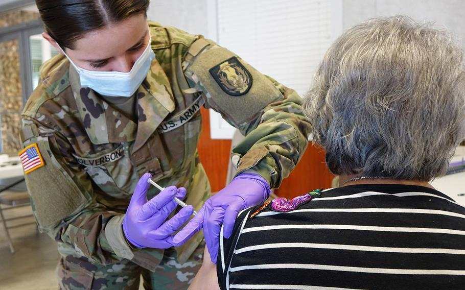 A Texas National Guard medic administers coronavirus vaccine on Jan.29, 2021, in Cuero, Texas. On Friday, Defense Secretary Lloyd Austin announced that more than 1,000 active-duty troops will join the vaccination efforts at multiple locations throughout the U.S.