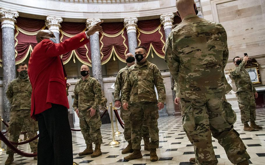 Off-duty National Guard troops learn about the history of the U.S. Capitol in the building's rotunda on Feb. 4, 2021.