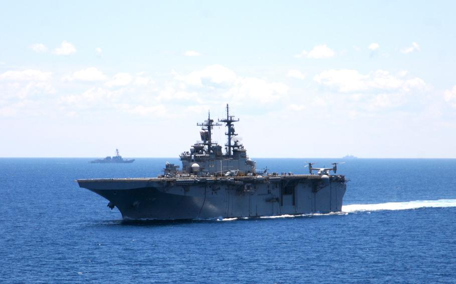 The USS Wasp transits the Atlantic Ocean while participating in the War of 1812 fleet exercise on June 27, 2012. A sailor assigned to the amphibious assault ship died from complications of the coronavirus, the U.S. Navy announced Friday.