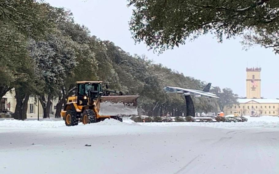 Barksdale Air Force Base near Bossier City, La., was blanketed by a mixture of snow, sleet and freezing rain that closed the base Tuesday. It was one of at least a dozen military bases to close Tuesday as a winter storm swept across portions of the southern and eastern United States.
