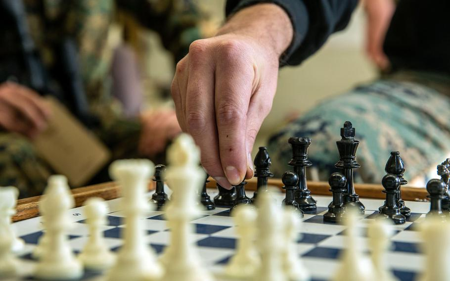 Marine Sgt. Alec Escalante, a squad instructor with Alpha Company, Infantry Training Battalion, School of Infantry-West, moves a chess piece during a class on how chess correlates with battle tactics, as part of the first week of the Infantry Marine Course at SOI-West on Marine Corps Base Camp Pendleton, Calif., Jan. 27, 2021.