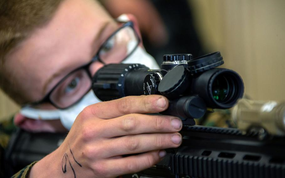 Marine Pvt. Francesco Baffa, a student with Alpha Company, Infantry Training Battalion, School of Infantry-West, aligns the optics on his rifle as part of the first week of the infantry course at Marine Corps Base Camp Pendleton, Calif., Jan. 27, 2021.