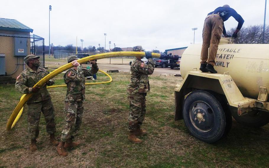 """Fort Hood provided drinking water Sunday support to central Texas communities recovering from a record-setting winter storm. About 20 400-gallon """"water buffalo"""" trailers delivered water at the request of civil authorities. Residents were faced with water shortages and boil notices, straining the remaining supply of water after power failures and burst pipes. Soldiers assigned to the 1st Cavalry Division and 13th Expeditionary Sustainment Command participated in the water distribution mission."""