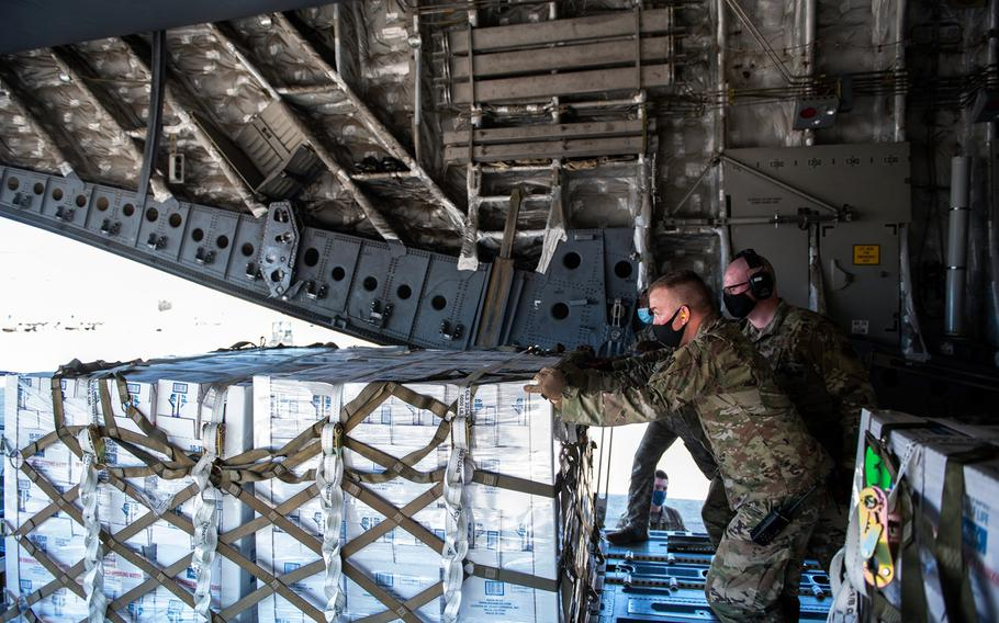 Airmen with the 502nd Logistics Readiness Squadron assist with the coordinating and unloading of more than 57,000 bottled water on a C-17 aircraft from the 16th Airlift Squadron, Joint Base Charleston, S.C., on Feb. 21 at Joint Base San Antonio-Kelly Field in Texas. The 502nd LRS assisted with the coordinating and unloading of more than 150,000 pounds of bottled water brought in via aircraft to be distributed in San Antonio.