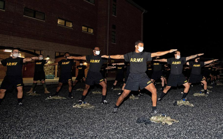 Trainees with 3rd Battalion, 34th Infantry Regiment participate in yoga training on Oct. 29, 2020. The Army is evaluating whether a pilot program incorporating yoga and meditation aided basic training platoons.