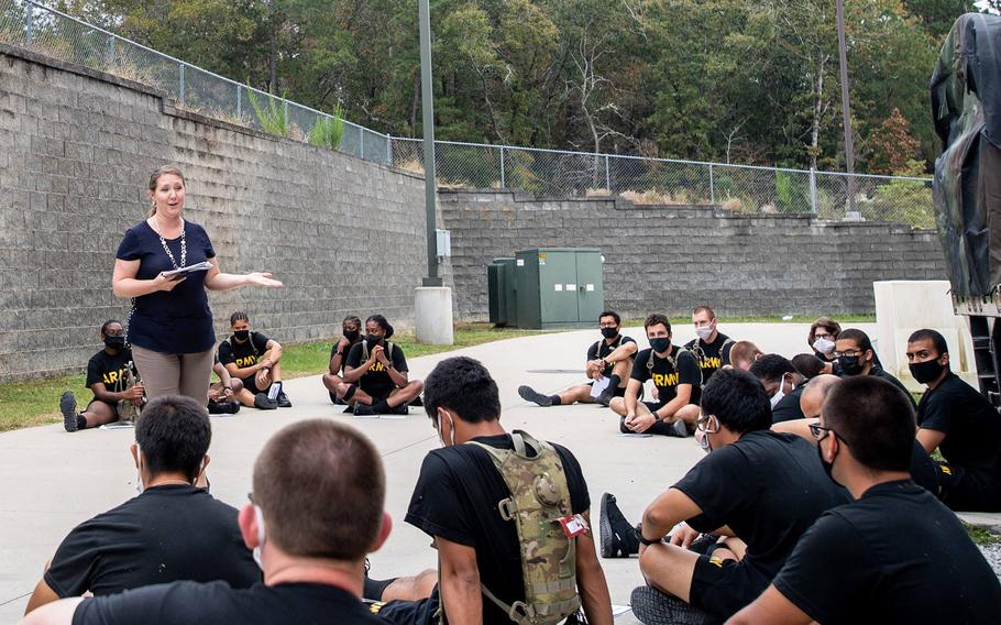 Dr. Treva Anderson gives trainees with the 3rd Battalion, 34th Infantry Regiment a briefing on mindfulness training on Oct. 28, 2020. The Army is evaluating whether a pilot program incorporating yoga and mindfulness meditation affected factors such as physical performance and stress management.