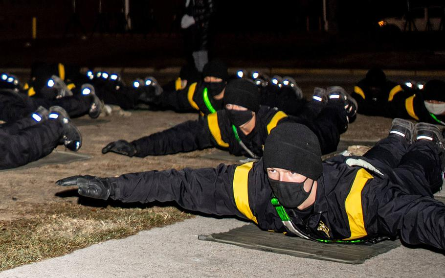 Trainees with 2nd Battalion, 60th Infantry Regiment do yoga as part of a pilot program, Dec. 8. 2020. The Army is evaluating whether a the program, incorporating yoga and mindfulness meditation, affected factors such as physical performance and stress management.