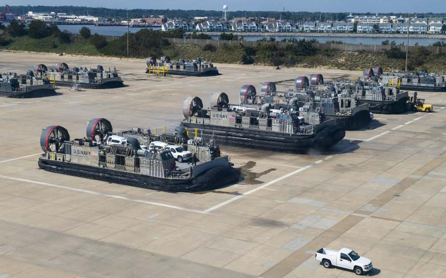 Service members from Joint Task Force Civil Support and Assault Craft Unit 4 move vehicles from Joint Expeditionary Base Little Creek-Fort Story to Fort Eustis on Sept. 16, 2019, during a mobile exercise. A sailor assigned to Assault Craft Unit 4 based at Joint Expeditionary Base Little Creek in Virginia Beach is the fourth sailor to die in February from the coronavirus, the Navy announced Tuesday.