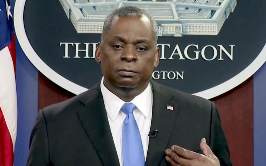 Defense Secretary Lloyd Austin speaks to service members about the coronavirus vaccine in this screenshot of a video released by the Pentagon, Wednesday, Feb. 24, 2021.