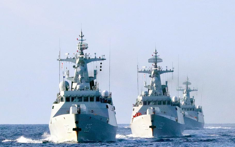 Three Chinese warships steam in formation during a training exercise in the South China Sea on Jan. 4, 2021. China spent the second most on defense worldwide, after the U.S., according to an International Institute for Strategic Studies report released Feb. 25, 2021.