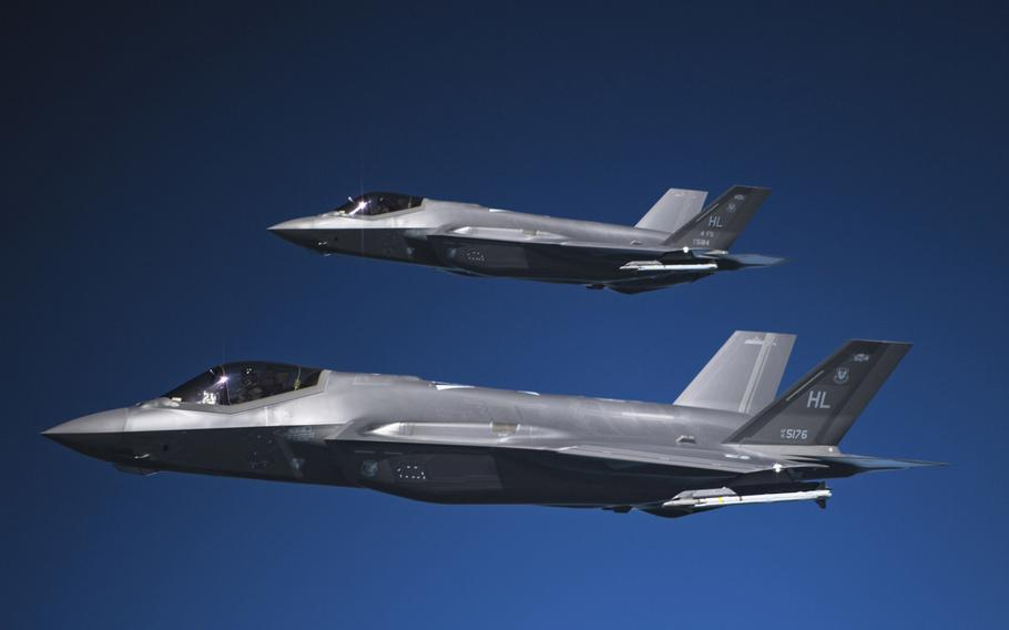 Two F-35A Lightning IIs fly in formation after receiving fuel from a KC-135R Stratotanker in May 2019 over an undisclosed location. The U.S. remained the top spender on defense in 2020, accounting or 40.3 % of global spending, the International Institute for Strategic Studies said Feb. 25, 2021.