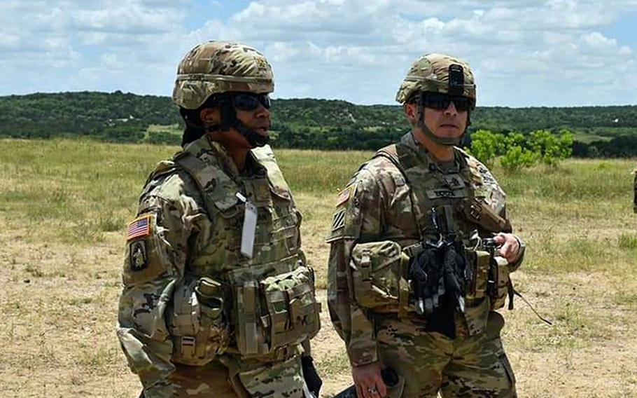 Maj. Jamie Hickman, left, a Fort Hood, Texas-based solider now on a rotational Army mission in Europe, says the military needs to continue making changes to ensure equal opportunity.