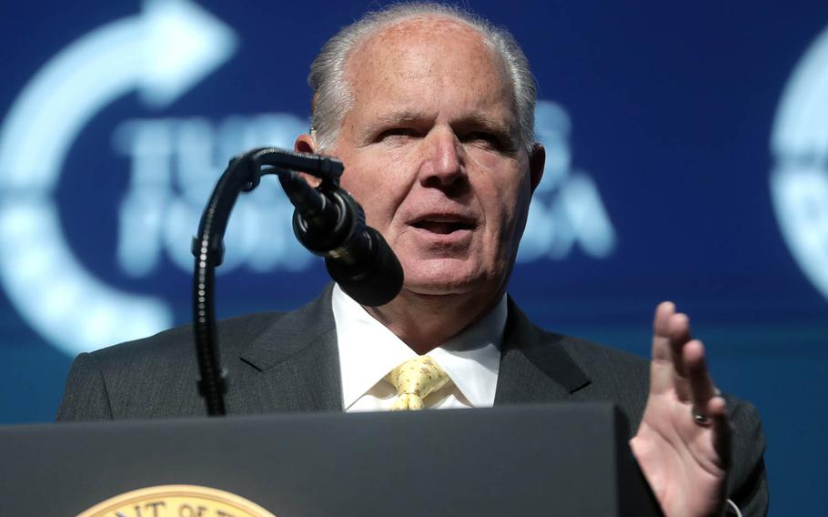 Conservative talk radio host Rush Limbaugh introduces President Donald Trump at the Turning Point USA Student Action Summit in West Palm Beach, Fla., Dec. 21, 2019. Not everyone is happy that American Forces Network is airing a compilation of late conservative radio host Rush Limbaugh's programming in the wake of his death last month.