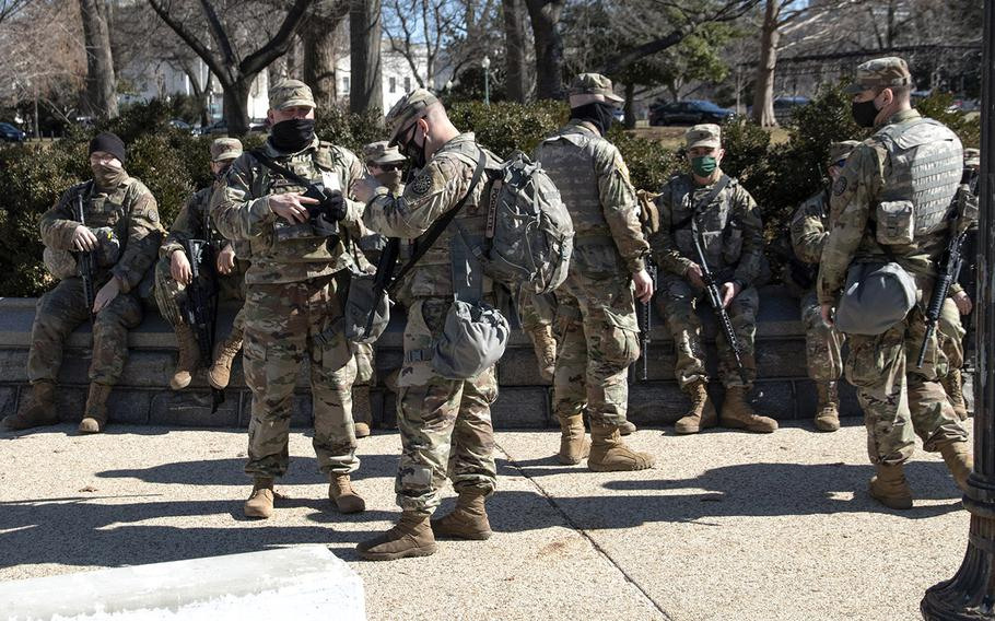 National Guard soldiers wait near the U.S. Capitol on March 3, 2021.