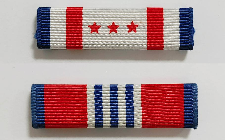 The District of Columbia National Guard Presidential Inauguration Support Ribbon, top, and the District of Columbia Emergency Service Ribbon. The D.C. National Guard plans to award at least one of two ribbons to all soldiers and airmen who supported the security mission before, during and after the 59th presidential inauguration in recognition of their service.