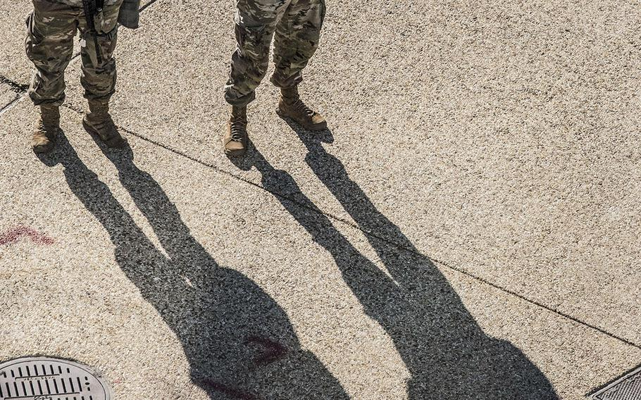 National Guard soldiers stand on Constitution Ave. in Washington, D.C., on March 3, 2021.
