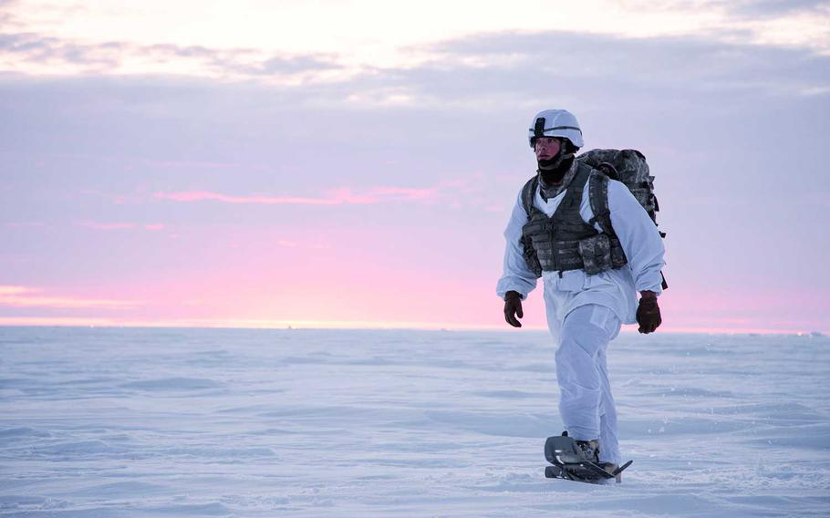 Sgt. Jeremy Hazard snowshoes across the tundra after conducting an airborne operation during exercise Arctic Pegasus in Deadhorse, Alaska, May 1, 2014. The Army needs to reinvigorate how it trains, equips and positions troops in the Arctic region as competition with Russia and China grows, according to the service's new strategy document released Tuesday.