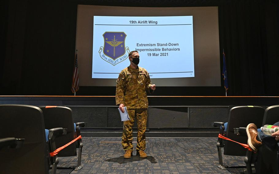 Lt. Col. Ryan Polcar, 19th Airlift Wing director of staff, discusses impermissible behaviors with members of the 19th Air Wing during the Extremism Stand-Down Day at Little Rock Air Force Base, Ark., on March 19, 2021.