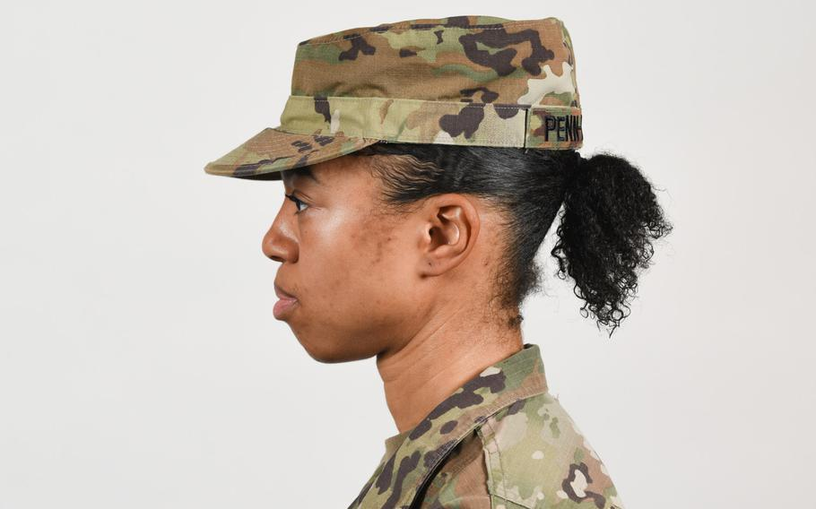 A soldier poses for a photo with medium-length hair secured into a ponytail, as authorized in Army grooming standards in January 2021. Sgt. Maj. of the Army Michael Grinston tweeted recently that long ponytails will be allowed with all uniforms. Currently, they are allowed only during physical training or with the Army Combat Uniform.