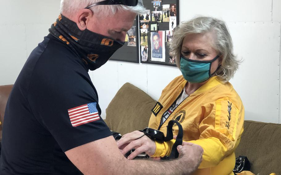 Ellen Comfort and Army Lt. Col. Ken Ates, Special Operations Command Para-Commando, rehearse skydiving procedures March 13, 2021, prior to a jump in Zephyrhills, Fla. Comfort is the Gold Star mother of Capt. Kyle Comfort, an Army Ranger who died during combat operations in Afghanistan in 2010.