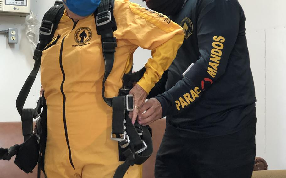 Sandee Rouse, Gold Star mother, and Army Sgt. Maj. Jose Vazquez, Special Operations Command Para-Commando, connect a tandem harness before a skydive March 13, 2021. Rouse's son, Army Pfc. Jim Markwell, a medic with the 1st Battalion, 75th Ranger Regiment, died Dec. 20, 1989 during Operation Just Cause in Panama.