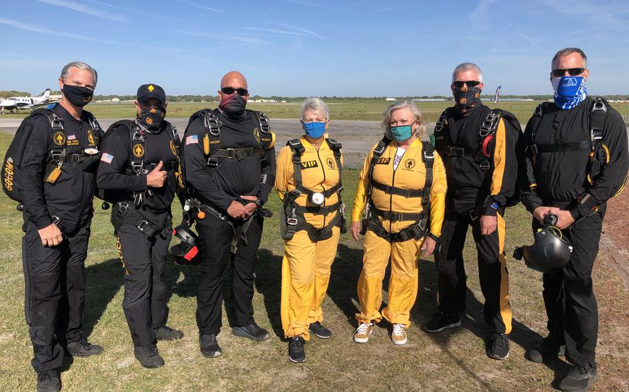U.S. Special Operations Command Para-Commandos prepare to tandem skydive with Gold Star mothers Sandee Rouse and Ellen Comfort, March 13, 2021, in Zephyrhills, Fla. Rouse's son, Pfc. Jim Markwell, died during Operation Just Cause in Panama in 1989. Comfort's son, Capt. Kyle Comfort, died during combat operations in Afghanistan in 2010.