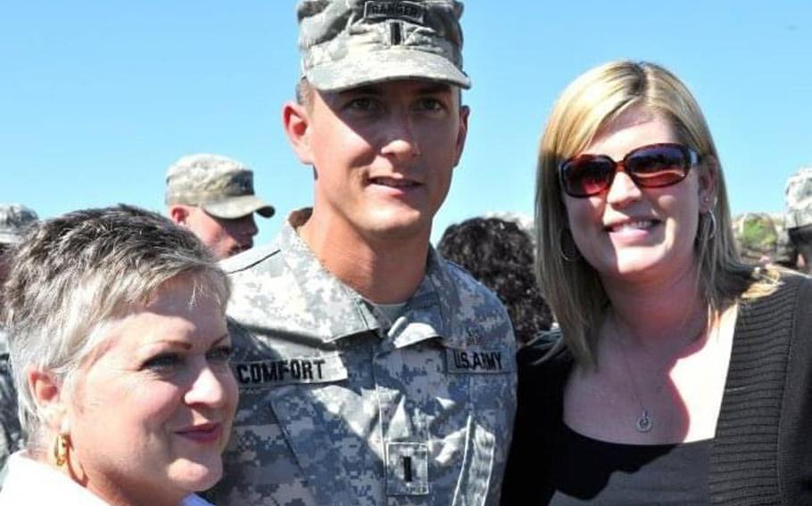 Ellen Comfort, her son Army 1st Lt. Kyle Comfort, and his wife, Brooke Comfort, enjoy time together after his graduation from Airborne school in March 2010. He deployed to Afghanistan the following week and was killed in action May 8, 2010.