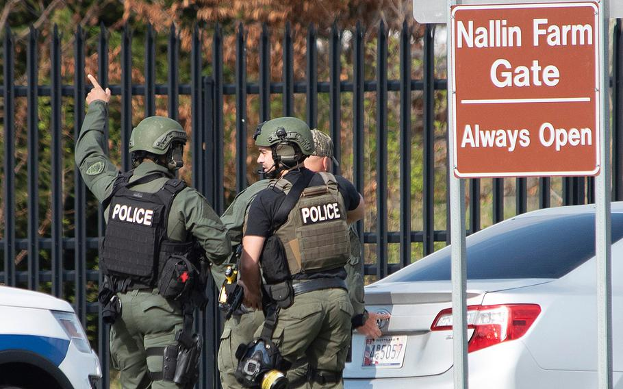 Members of the Frederick Police Department Special Response Team prepare to enter Fort Detrick at the Nallin Farm Gate following a shooting Tuesday, April 6, 2021, in northeast Frederick, Md. Authorities said a Navy medic shot and critically wounded two people at a Maryland business park before fleeing to the Army base, where he was shot and killed.