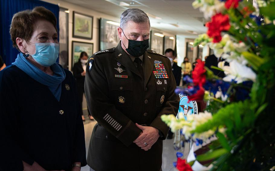 Army Gen. Mark A. Milley, chairman of the Joint Chiefs of Staff, pays respects on Wednesday, April 7, 2021, at the Pentagon during the Defense POW/MIA Accounting Agency (DPAA) ceremony commemorating the 20th Anniversary of a helicopter crash in Vietnam.