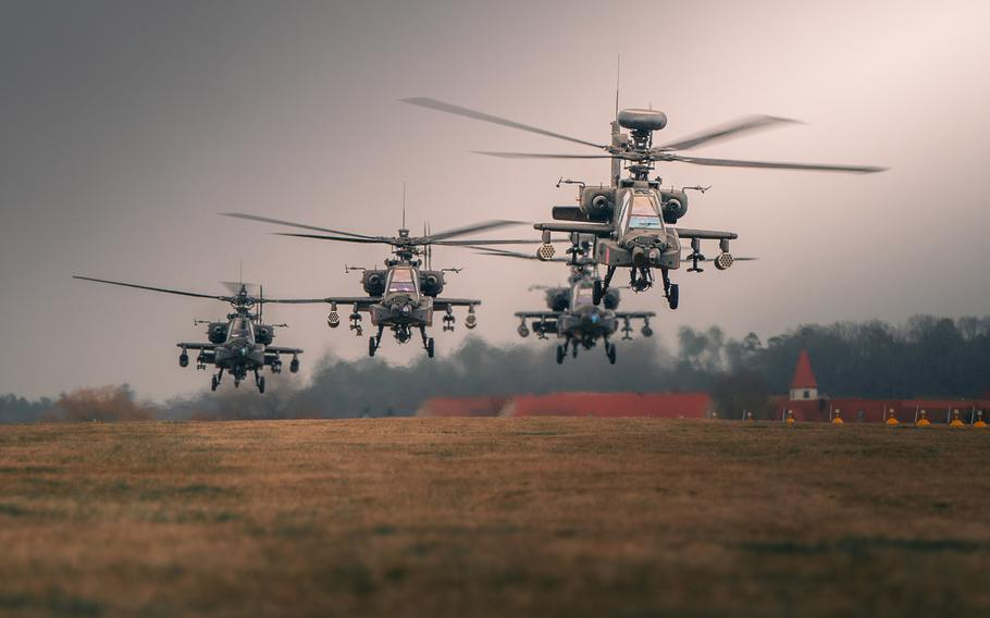 AH-64 Apache attack helicopters of the 12th Combat Aviation Brigade launch from Katterbach Army Airfield, Germany, for a battalion training mission, March 17, 2021. Pilot shortages hindered the Army's Apache operations in recent years, the Government Accountability Office said in a report released April 7, 2021.