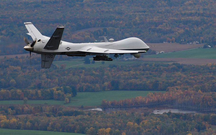 An MQ-9 Reaper drone operated by the New York Air National Guard's 174th Attack Wing flies a training mission over central New York in 2016. Confusion over control levers led to the crash and loss of one of the unit's $6 million drones in June 2020, a recently released investigation report has found.
