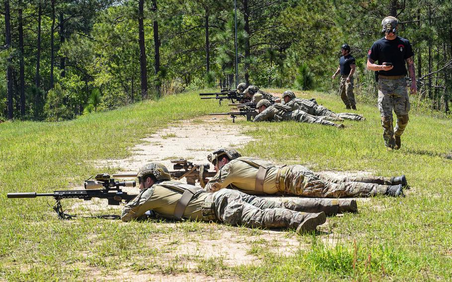 Army Sniper School cadre look on as snipers compete in the heartbreaker event during the Best Sniper competition at Fort Benning in Georgia on Monday, April 12, 2021.