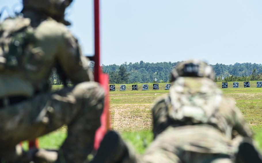 Army snipers eye targets down range during the heartbreaker event on the first day of the service's Best Sniper competition on Monday, April 12, 2021 at Fort Benning, Ga.