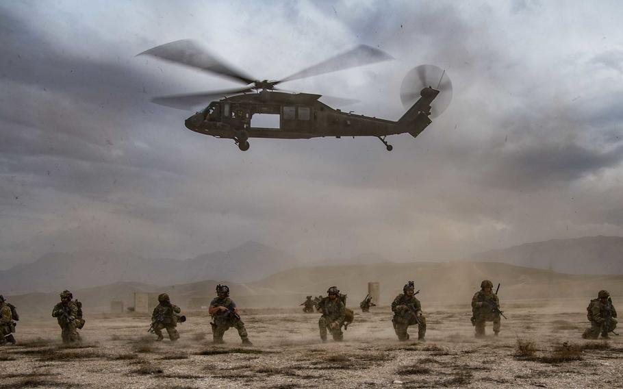 U.S. service members secure the perimeter at an undisclosed location in Afghanistan in March 2020. President Joe Biden formally announced Wednesday, April 14, 2021, that the U.S. will remove the remaining 2,500 or so U.S. troops from Afghanistan by Sept. 11, 2021.