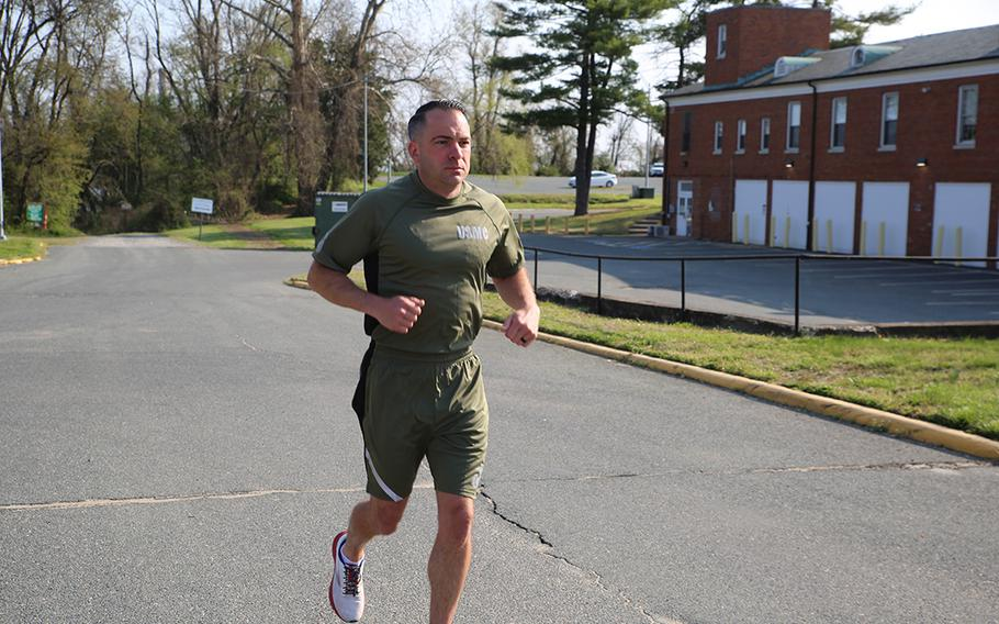 A Marine demonstrates a prototype version of the new Physical Training Uniform. The new shirt and shorts will be tested and evaluated by 500 Marines. The uniform will provide a more athletic fit that aligns with today's commercial clothing trends.