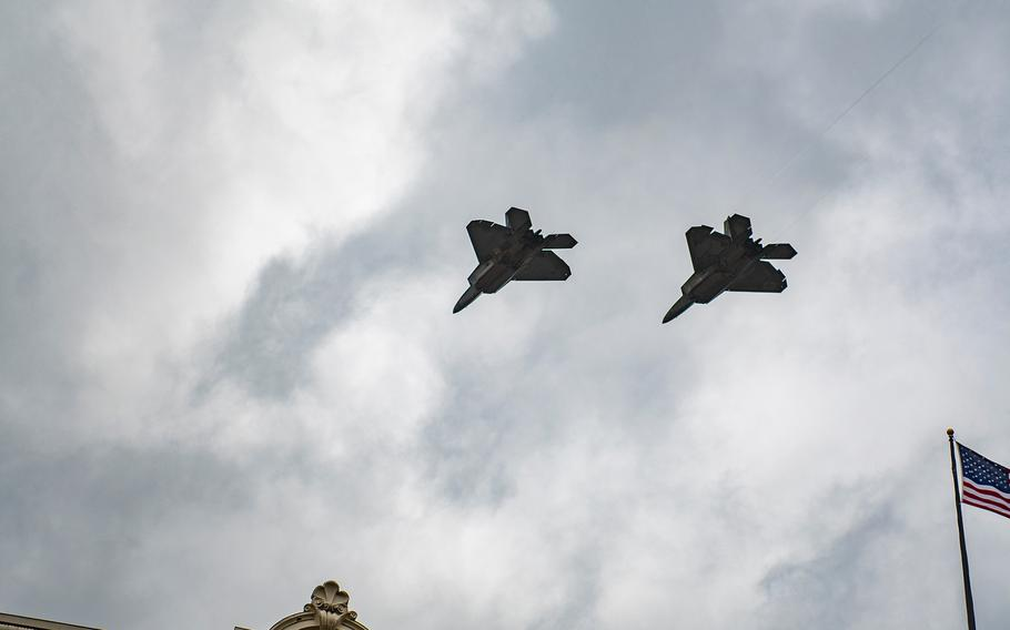Two F-22 Raptors roar overhead after the U.S. flag was raised for the first time at the new World War I Memorial in Washington, D.C.,  on Friday, April 16, 2021, during a a dedication ceremony.
