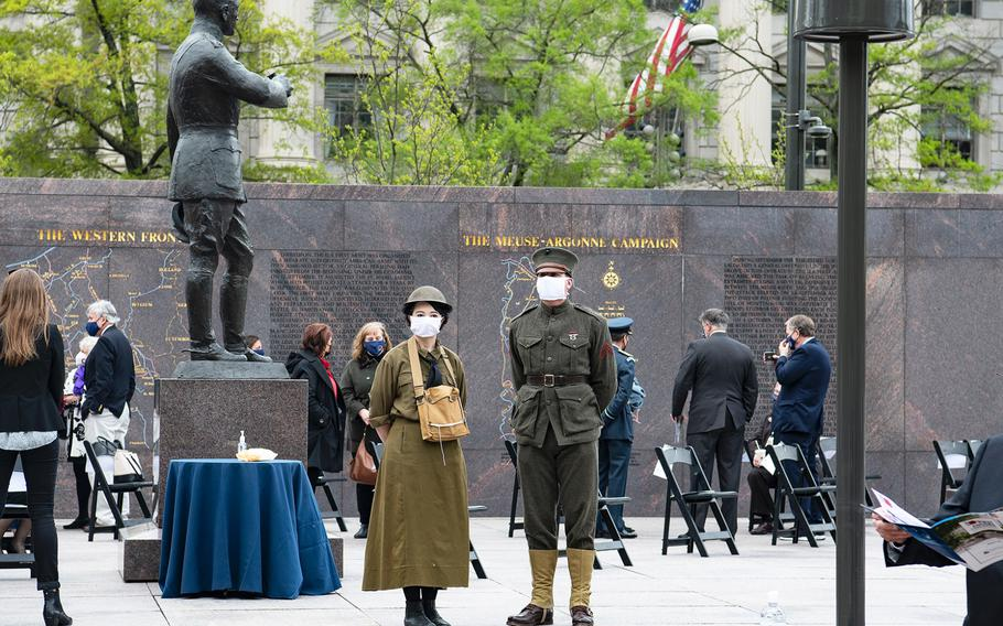 Marine veteran Chris Kuhns with his wife Gabrielle stand dressed in World War I-era uniforms on Friday, April 16, 2021, just prior to a dedication ceremony for the new WWI Memorial in Washington, D.C., just a block from the White House grounds.