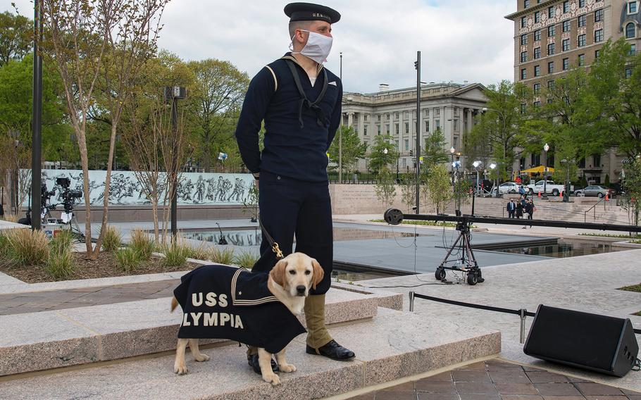 Tom Frezza and his dog Shea wear World War I-era uniforms on Friday, April 16, 2021, at a dedication ceremony for the new WWI Memorial in Washington, D.C.