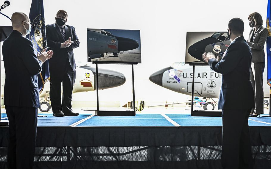 Mayor Rusty Hike of Bellevue, Nebraska, unveils the new nose art in homage to the old Lincoln Air Force Base with Mayor Leirion Gaylor Baird of Lincoln, Nebraska, April 16, 2021, at the Nebraska National Guard air base in Lincoln. The 55th Wing will be relocated in Lincoln during runway renovations at Offutt Air Force Base for the next 18 months.