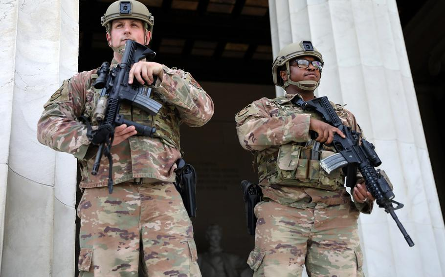 In a June 2, 2020 photo, District of Columbia National Guard airmen stand guard at the Lincoln Memorial after being deployed in response to protests and riots after the death of George Floyd.