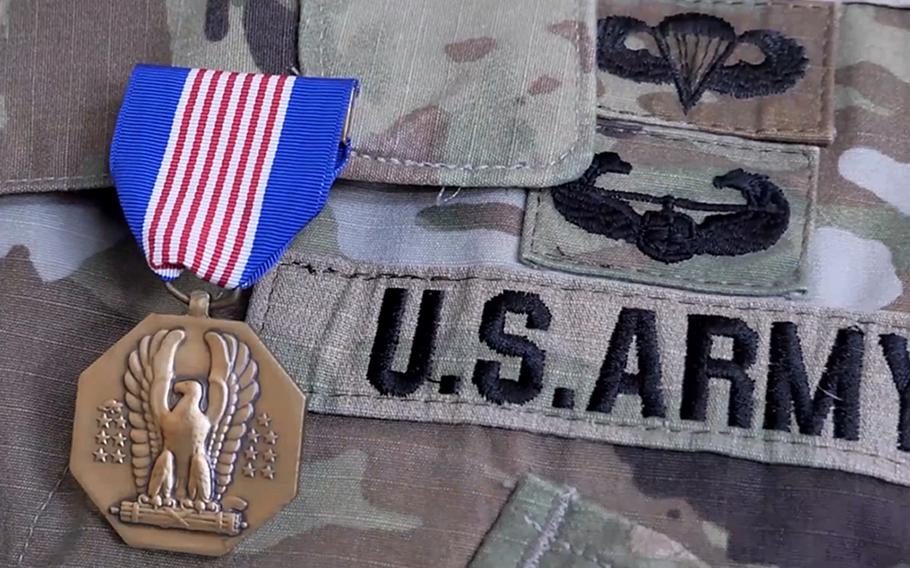 The Soldier's Medal is displayed on Sgt. 1st Class Jedidia Powell's chest on April 10, 2021, during a ceremony at Camp Withycombe, Ore. Powell ran into a burning house, helping two women and a dog in 2017.