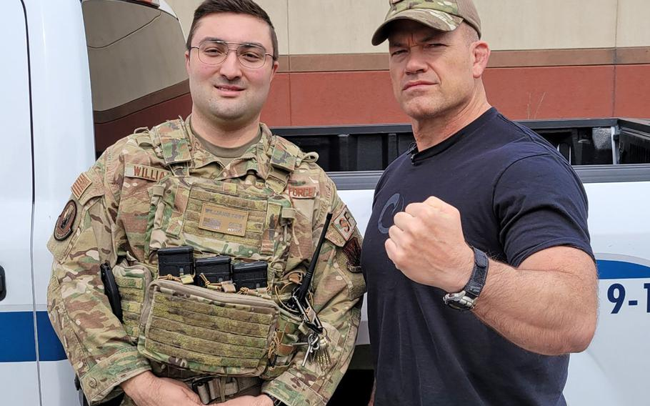 Pennsylvania Air National Guard Tech Sgt. Anthony Williams poses with John Gretton ''Jocko'' Willink, a retired Navy SEAL officer at  Biddle Air National Guard Base, Pa., April 19, 2021. Williams was on duty when Willink paid an impromptu visit to the base.