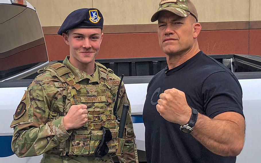 Pennsylvania Air National Guard Airman 1st Class William Guilfoyle poses with John Gretton ''Jocko'' Willink, a retired Navy SEAL officer, at Biddle Air National Guard Base, Pa., April 19, 2021.