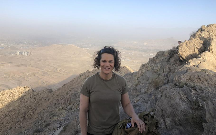 Transgender service member, then-Capt. Alivia Stehlik, poses for a photo in the mountains of Afghanistan during her 2018 deployment. Stehlik traveled from base to base, providing physical therapy to troops during the year she spent in the country.