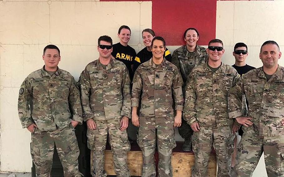 Then-Army Capt. Alivia Stehlik, front row center, stands with other medical staff during her deployment to Afghanistan in 2018.