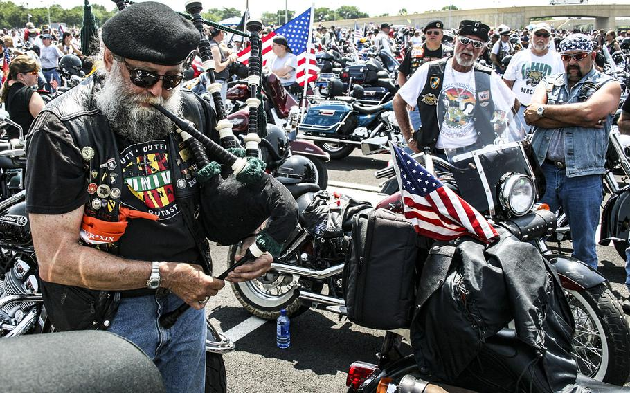 In a 2006 photo, a bagpiper plays as he walks between motorcycles in a Pentagon parking lot before the annual Rolling Thunder rally.