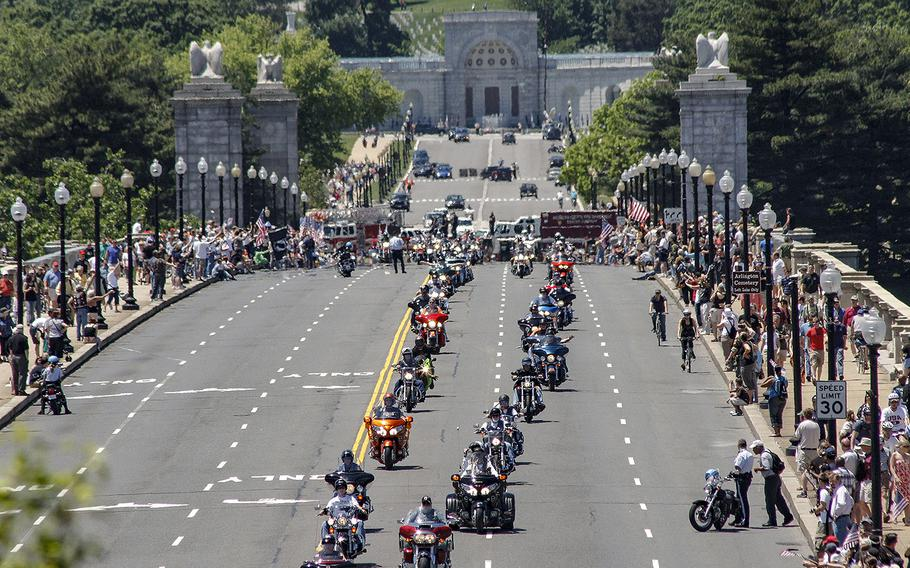 In a 2008 photo, crowds line the bridge at Arlington National Cemetery as Rolling Thunder riders cross into Washington, D.C.