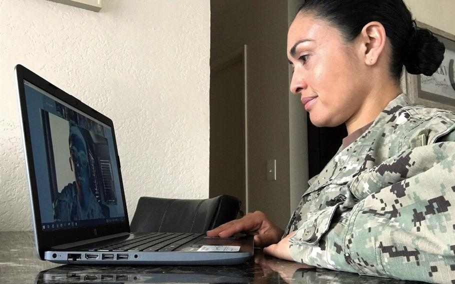 In a May 16, 2020 photo, Mass Communication Specialist 2nd Class Natalia Murillo participates in a video conference with Navy Public Affairs Support Element (NPASE) West during a drill weekend. NPASE reserve units paused in-person drills as early as March in accordance with Navy-wide coronavirus precautions.
