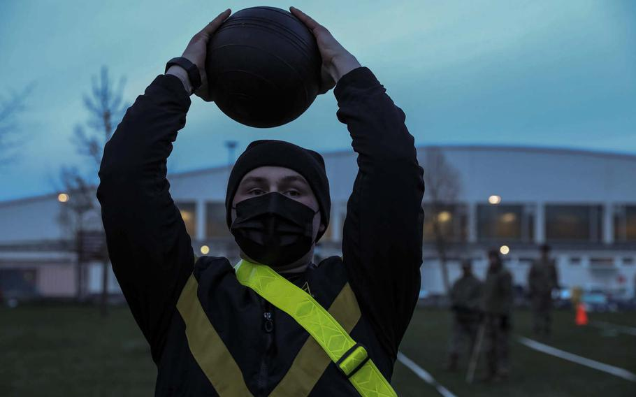 Spc. Taylor Brown, 11th Missile Defender Battery, 10th Army Air and Missile Defense Command, attempts the standing power throw during the Army Combat Fitness Test at Ansbach, Germany, April 13, 2021.
